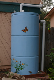 Painted ferrocement rainwater cistern with custom artwork picture
